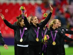 Alex Morgan and the U.S. women's soccer team celebrate after winning the gold medal.