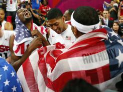 Kevin Durant (left), Anthony Davis (middle), and Carmelo Anthony celebrate after defeating Spain to win the gold medal at the London Olympics.