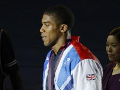 Britain's Anthony Joshua walks with his gold medal after the men's super heavy weight final bout during the London 2012 Olympic Games at ExCeL.
