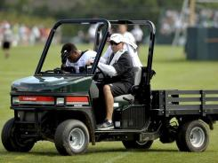 Eagles training staff transport cornerback Nnamdi Asomugha off the field Monday after Asomugha collided with safety Nate Allen during practice.