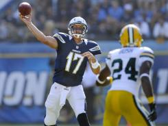 Chargers quarterback Philip Rivers throws a pass during a preseason game against the Packers at Qualcomm Stadium.