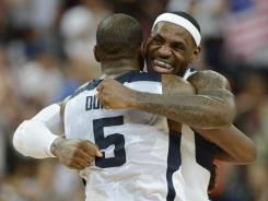 USA forward LeBron James (6) hugs USA guard Kevin Durant (5) after winning the gold in the men's basketball final against Spain in the London 2012 Olympic Games at North Greenwich Arena.