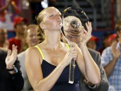 Petra Kvitova kisses her trophy after defeating Li Na 7-5, 2-6, 6-3 to win the final of the WTA 2012 Rogers Cup.