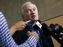 Donald Fehr, executive director of the NHL Players Association, speaks to journalists after leaving labor negotiations with the NHL.