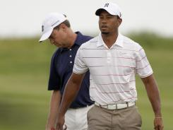 U.S. Ryder Cup captain Davis Love III, left, and team member Tiger Woods converse during a practice round at last week's PGA Championship at Kiawah Island, S.C. Love has three weeks to add captain's picks for the event Sept. 28-30 at Medinah (Ill.) Country Club.