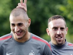French soccer players Karim Benzema, left, and Franck Riberty will be tried by a criminal court.