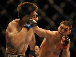 Nick Diaz, right, lost to Carlos Condit during UFC 143