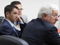 Robby Albarado, left, with his legal team on the last day of his assault trial on July 12. Albarado was convicted of assaulting his former girlfriend.