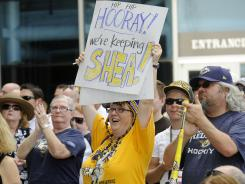 Jean Wilson and other fans applaud the Nashville Predators' decision last month to match an offer sheet to Shea Weber.
