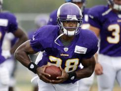 Vikings running back Adrian Peterson took part in practice with pads for the first time Tuesday.