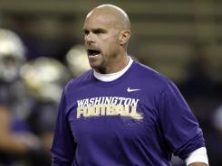 Nick Holt, fired as Washington's defensive coordinator after last season, has worked twice previously with Arkansas head coach John L. Smith.