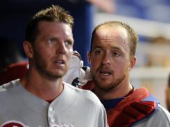 Phillies catcher Erik Kratz (right) talks with starting pitcher Roy Halladay (left) during their loss to the Marlins.