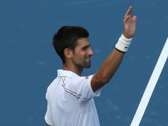 Novak Djokovic of Serbia acknowledges cheers Wednesday after defeating Andreas Seppi of Italy during at the Western &amp; Southern Open in Mason, Ohio.