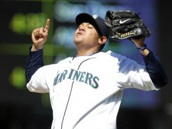 Mariners ace Felix Hernandez celebrates the final out of his perfect game against the Rays at Safeco Field in Seattle.