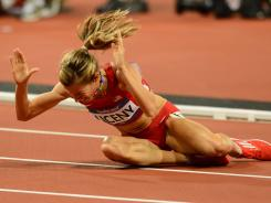 The USA's Morgan Uceny vents her frustration on the Olympic track after falling during the final of the 1,500 meters Aug.10.