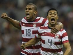 Michael Orozco Fiscal, right, celebrates with teammate Terrence Boyd after scoring in the 80th minute, the only goal of the match.