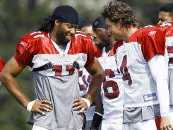 WR Larry Fitzgerald is key to the Cardinals' success, whether or not QB Kevin Kolb (4) is throwing to him.