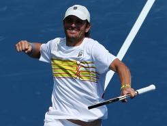 Mardy Fish of the USA exults after defeating Radek Stepanek of the Czech Republic to reach the quartefinals of the Western & Southern Open on Thursday in Mason, Ohio.