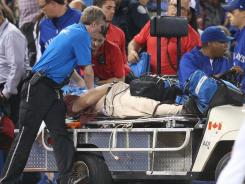Paramedics attempt to resuscitate a fan sitting on the front row during Thursday's game between the White Sox and Blue Jays at Rogers Centre.