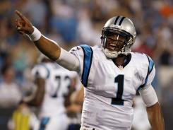 Panthers QB Cam Newton reacts after a touchdown against the Dolphins on Friday night.