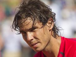 Rafael Nadal of Spain says he won't rush back from his knee injury.