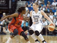 Lynx point guard Lindsay Whalen, right, dribbling past Mystics guard Shannon Bobbitt, tallied 10 points and nine assists in just 19 minutes of action.