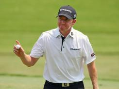 Jimmy Walker waves to the crowd after making birdie on the 17th hole Friday during the second round of the Wyndham Championship.