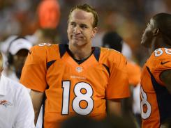 Broncos quarterback Peyton Manning (18) reacts after throwing an interception in the second quarter Saturday night against the Seahawks.