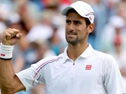 Novak Djokovic celebrates a point against Juan Martin Del Potro during the semifinals of the Western & Southern Open.