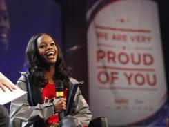 Olympic gold-medalist Gabby Douglas takes the stage during a homecoming celebration for Iowa-based Olympians in Des Moines on Saturday.