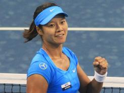 Li Na of China has begun working with a new coach, Carlos Rodriguez, who helped Justine Henin win seven major titles.