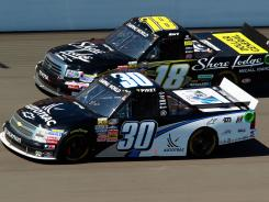 Nelson Piquet Jr. races by Kurt Busch, who was running in his first Camping World Truck Series race in 11 years. Piquet Jr. captured the win at Michigan for his first on the circuit.