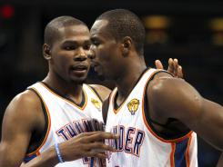 Oklahoma City Thunder small forward Kevin Durant (35) talks to Serge Ibaka (9) during a stop in play during the NBA Finals.