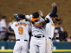 Orioles outfielders Nate McLouth, Nick Markakis (center) and Adam Jones celebrate after Baltimore's 3-2 win over Detroit.