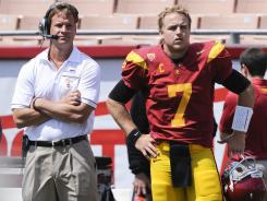 USC coach Lane Kiffin and quarterback Matt Barkley look on during a practice. USC is was named the No. 1 team in the AP poll with the return of Barkley.
