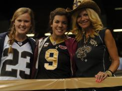 Saints fans Erin Holahan, Katie Fleuriet, and Cat Fleuriet before the preseason game against the Jacksonville Jaguars on Friday.