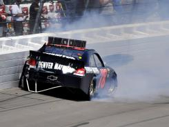 The No. 78 Chevy of Regan Smith wrecks after contact with Marcos Ambrose on lap 75.