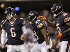 Chicago Bears running back Michael Bush (29) celebrates his one-yard touchdown run with quarterback Jay Cutler (6) and wide receiver Brandon Marshall (15) during a preseasongame against the Washington Redskins in Chicago, Saturday, Aug. 18, 2012.