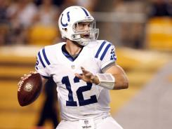 Colts quarterback Andrew Luck (12) drops back to pass against the Steelers Sunday night.