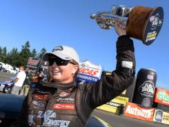 NHRA pro stock driver Erica Enders celebrates after winning at the Northwest Nationals at Pacific Raceways.