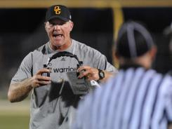 Oak Grove (Hattiesburg, Miss.) assistant coach Brett Favre helped his team defeat Sumrall in its opener Friday.
