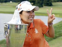 Mika Miyazato poses with her trophy after winning the LPGA Safeway Classic golf tournament on Sunday.