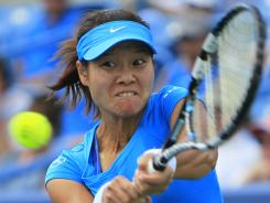 Li Na of China powers a backhand during her come-from-behind victory Sunday against Angelique Kerber of Germany in the final of the Western & Southern Open in Mason, Ohio.
