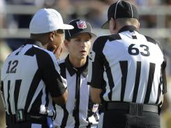 Replacement officials discuss a call during a Week 1 preseason game between the Green Bay Packers and San Diego Chargers.