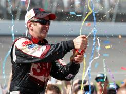 Greg Biffle celebrates his win (and points lead) in victory lane at Michigan International Speedway.