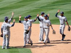 Rays players celebrate after finishing off a four-game sweep of the Angels.