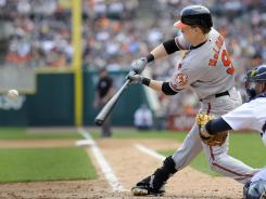Orioles outfielder Nate McLouth hits a triple to right field to drive in Nick Markakis and J.J. Hardy in the fourth inning of Baltimore's 7-5 win.
