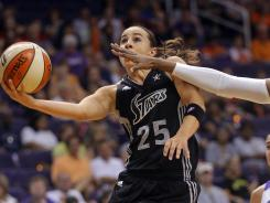 Silver Stars guard Becky Hammon (25) drives against the Mercury during the first half Sunday's game