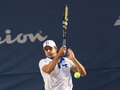 Andy Roddick returns a serve to James Blake during a match in the Winston-Salem Open at the Wake Forest University Tennis Complex in Winston-Salem, N.C. Roddick won the match 7-6 (8-6), 7-6 (8-6).