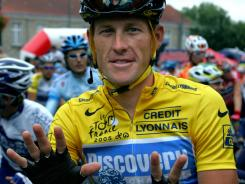 In a file photo dated July 24, 2005, Lance Armstrong shows seven fingers in reference to his seven Tour de France victories.